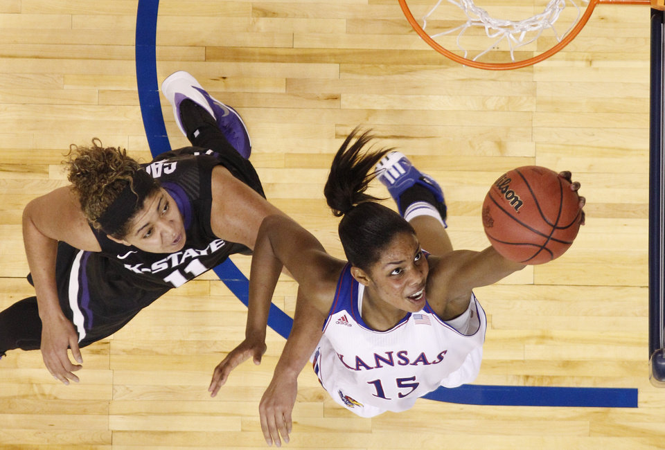 Photo - Kansas forward Chelsea Gardner (15) goes up for a shot in front of Kansas State forward Chantey Caron (11) in the first half of a Big 12 women's NCAA college basketball tournament game in Oklahoma City, Friday, March 7, 2014. Kansas won 87-84 in overtime. (AP Photo/Sue Ogrocki)