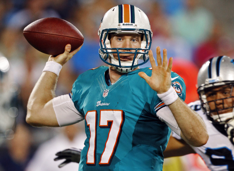 Photo -   FILE - In this Aug. 17, 2012, file photo, Miami Dolphins quarterback Ryan Tannehill (17) prepares to throw a pass against the Carolina Panthers during the first quarter of a preseason NFL football game in Charlotte, N.C. For the first time since the 1960s, the Dolphins (No. 27 in the AP Pro32) have endured three consecutive losing seasons, and the team is hoping that the consistently strong defense can lead an inexperienced offense to a different result this year. The Dolphins are scheduled to begin their regular season on Sept. 9 at the Houston Texans. (AP Photo/Chuck Burton, File)