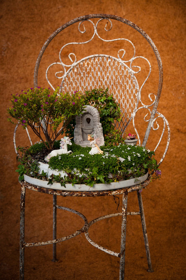"From ""Fairy Gardening"" by Julie Bawden-Davis and Beverly Turner, this fairy garden is created using an old metal chair as a planter. Photo provided."