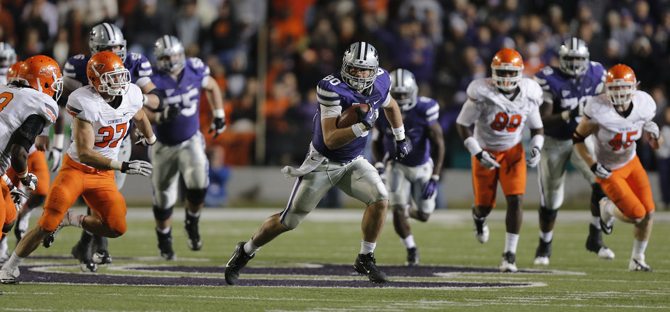 Photo - Kansas State's Travis Tannahill (80) runs past the Oklahoma State defense during the college football game between the Oklahoma State University Cowboys (OSU) and the Kansas State University Wildcats (KSU) at Bill Snyder Family Football Stadium on Saturday, Nov. 1, 2012, in Manhattan, Kan. Photo by Chris Landsberger, The Oklahoman