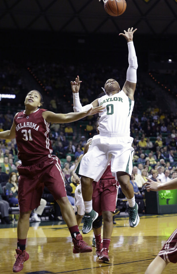 Photo - Baylor guard Odyssey Sims (0) shoots against Oklahoma forward Portia Durrett (31) during the first half of an NCAA college basketball game, Monday, Feb. 24, 2014, in Waco, Texas. (AP Photo/LM Otero)