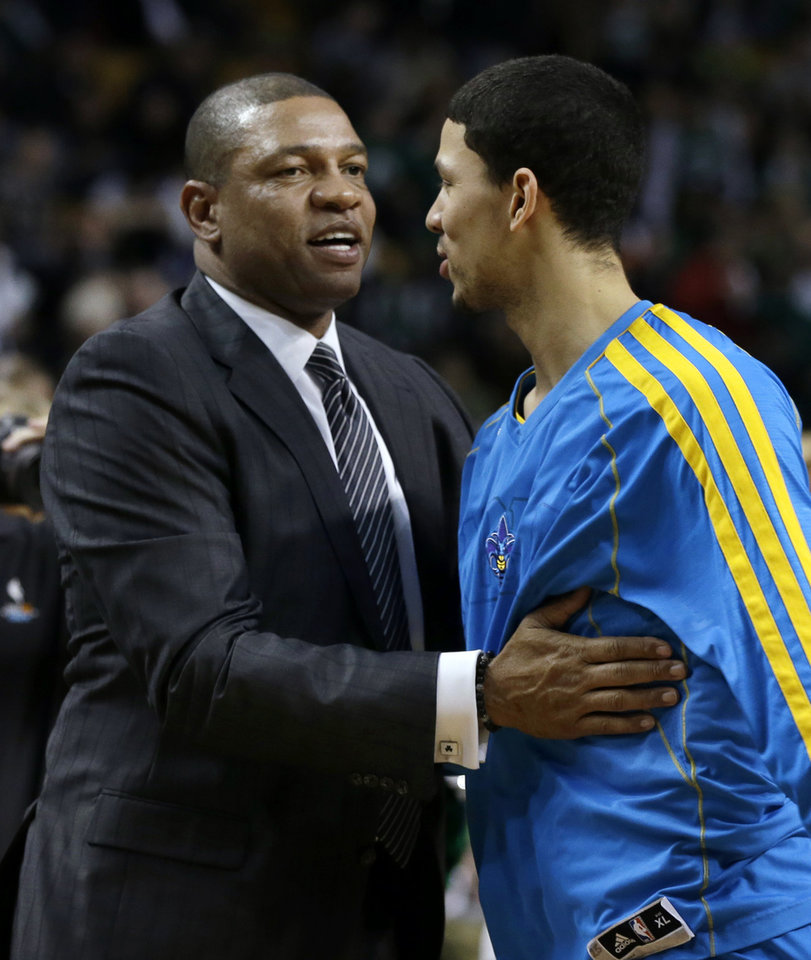 Photo - Boston Celtics head coach Doc Rivers, left, greets his son, New Orleans Hornets shooting guard Austin Rivers, prior to an NBA basketball game in Boston, Wednesday, Jan. 16, 2013. (AP Photo/Elise Amendola)