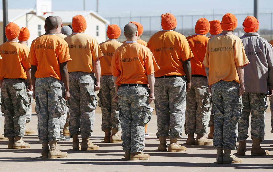 Photo -  Inmates line up in the yard at the Bill Johnson Correctional Center in Alva. [Photo by Nate Billings, The Oklahoman]