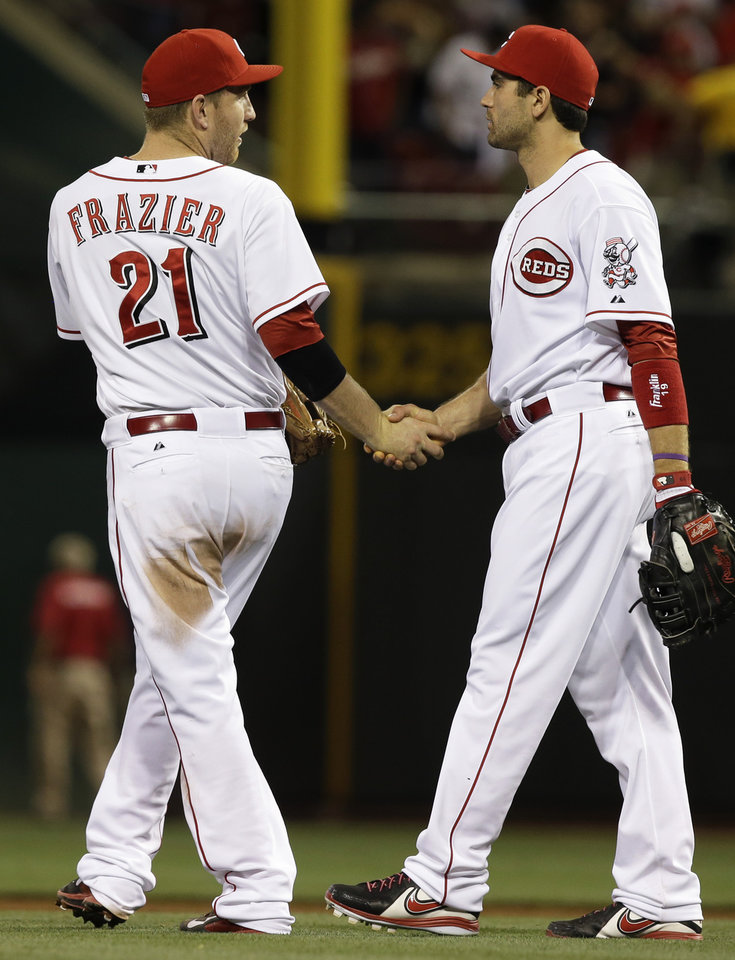 Photo - Cincinnati Reds' Todd Frazier (21) is congratulated by Joey Votto after the Reds defeated the St. Louis Cardinals 1-0 in a baseball game, Tuesday, Sept. 3, 2013, in Cincinnati. Frazier drove in the only run of the game with a double. (AP Photo/Al Behrman)