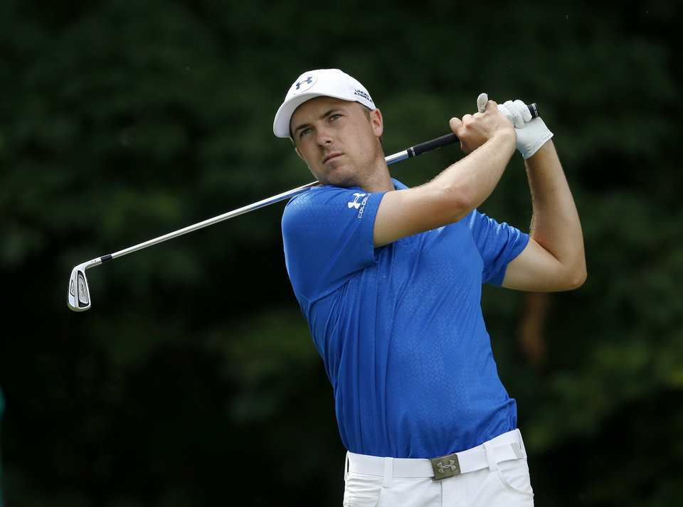 Photo - Jordan Spieth watches his drive on the 12th tee during the first round of the 2014 John Deere Classic golf tournament at TPC Deere Run in Silvis, Ill., Thursday, July 10, 2014. (AP Photo/Charles Rex Arbogast)