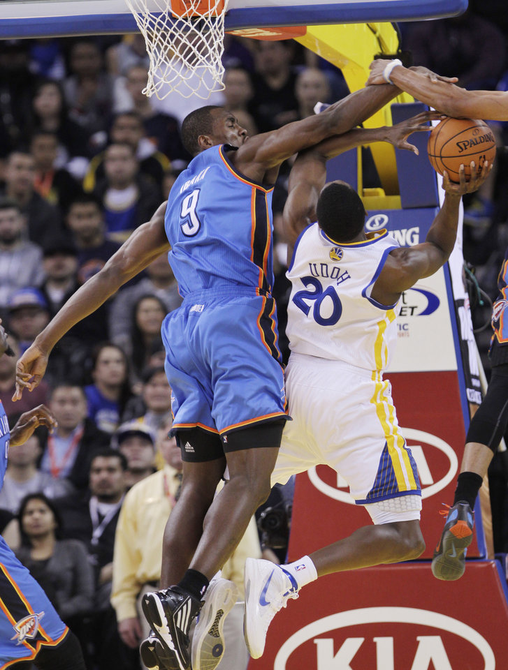 Golden State�s Ekpe Udoh, right, is closely guarded by the Thunder�s Serge Ibaka in the second quarter Tuesday. AP Photo