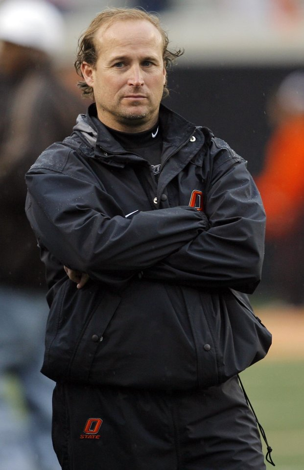 Photo - OSU offensive coordinator Dana Holgorsen watches during the Oklahoma State Orange and White spring football game at Boone Pickens Stadium in Stillwater, Okla., Saturday, April 17, 2010. Photo by Nate Billings, The Oklahoman