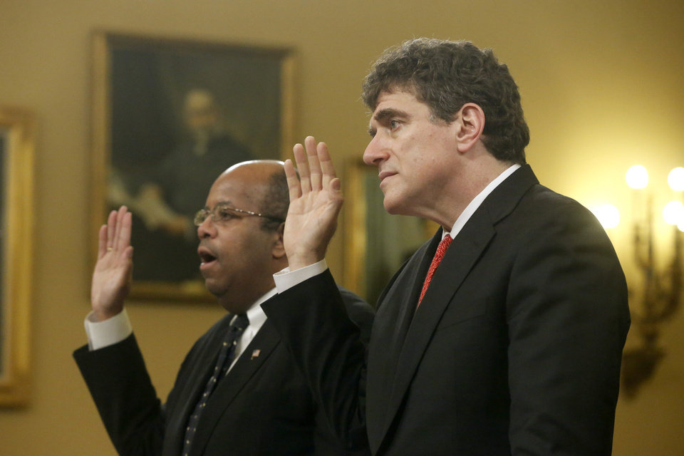 Photo - Ousted IRS chief Steve Miller, right, and J. Russell George, Treasury Inspector General for Tax Administration, are sworn in on Capitol Hill, in Washington, Friday, May 17, 2013, prior to testifying before the House Ways and Means Committee hearing on the Internal Revenue Service (IRS) practice of targeting applicants for tax-exempt status based on political leanings. (AP Photo/Charles Dharapak)