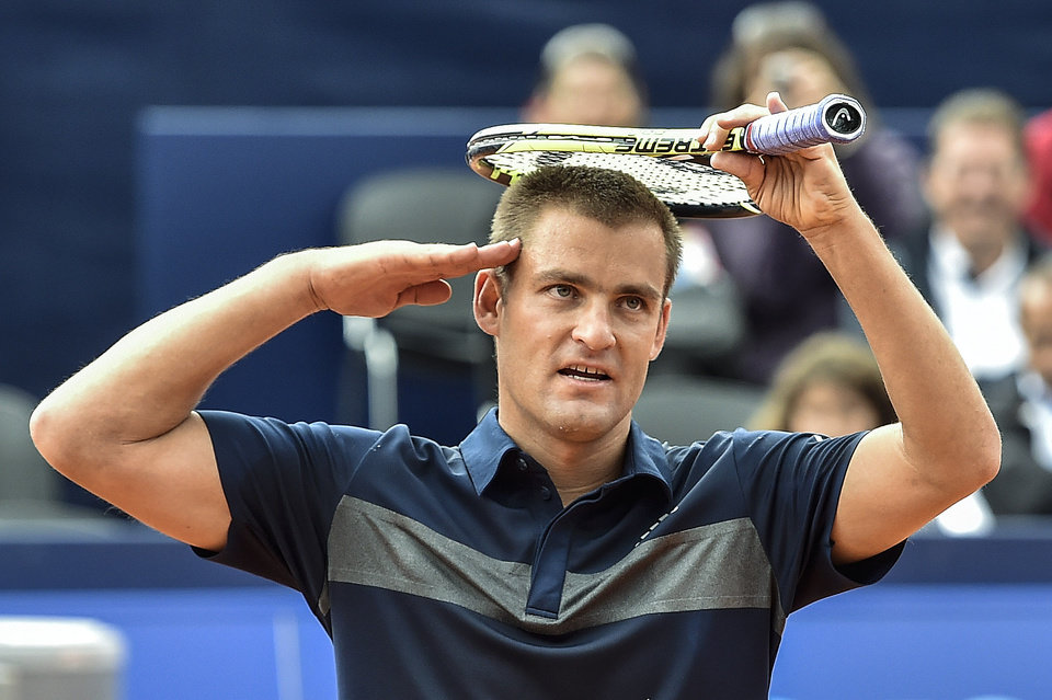 Photo - Mikhail Youzhny of Russia celebrates his victory against to Kenny De Schepper of France during the second round match at the Suisse Open tennis tournament in Gstaad, Switzerland, Thursday, July 24, 2014. (AP Photo/Keystone,Peter Schneider)