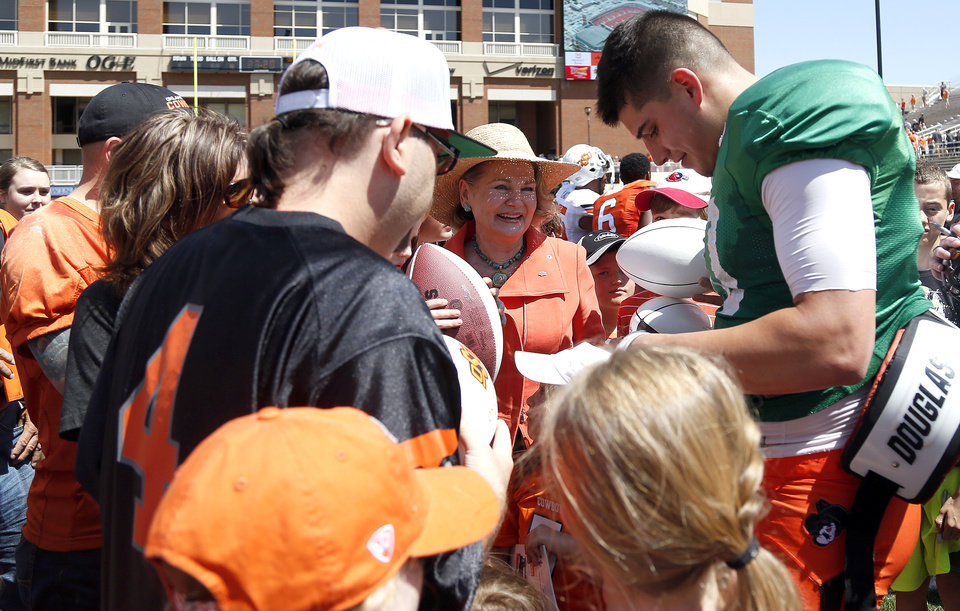 Photo - Mason Rudolph signs autographs for fans following the Oklahoma State University Spring football game at Boone Pickens Stadium in Stillwater, Okla., Saturday, April, 18, 2015. Photo by Sarah Phipps, The Oklahoman