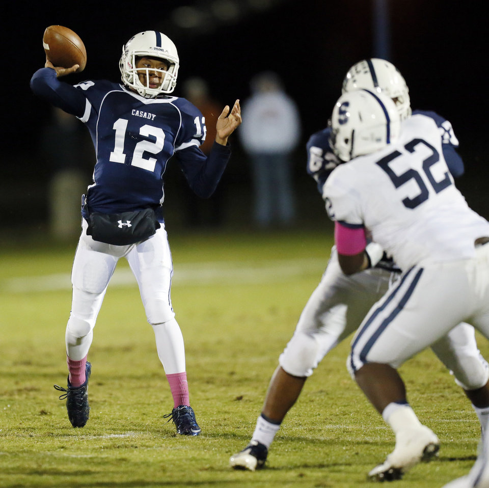 Casady's T'Quan Wallace (12) passes during a high school football game between Casady and Fort Worth All Saints Episcopal at Casady School in Oklahoma City,  Friday, Oct. 18, 2013. Photo by Nate Billings, The Oklahoman