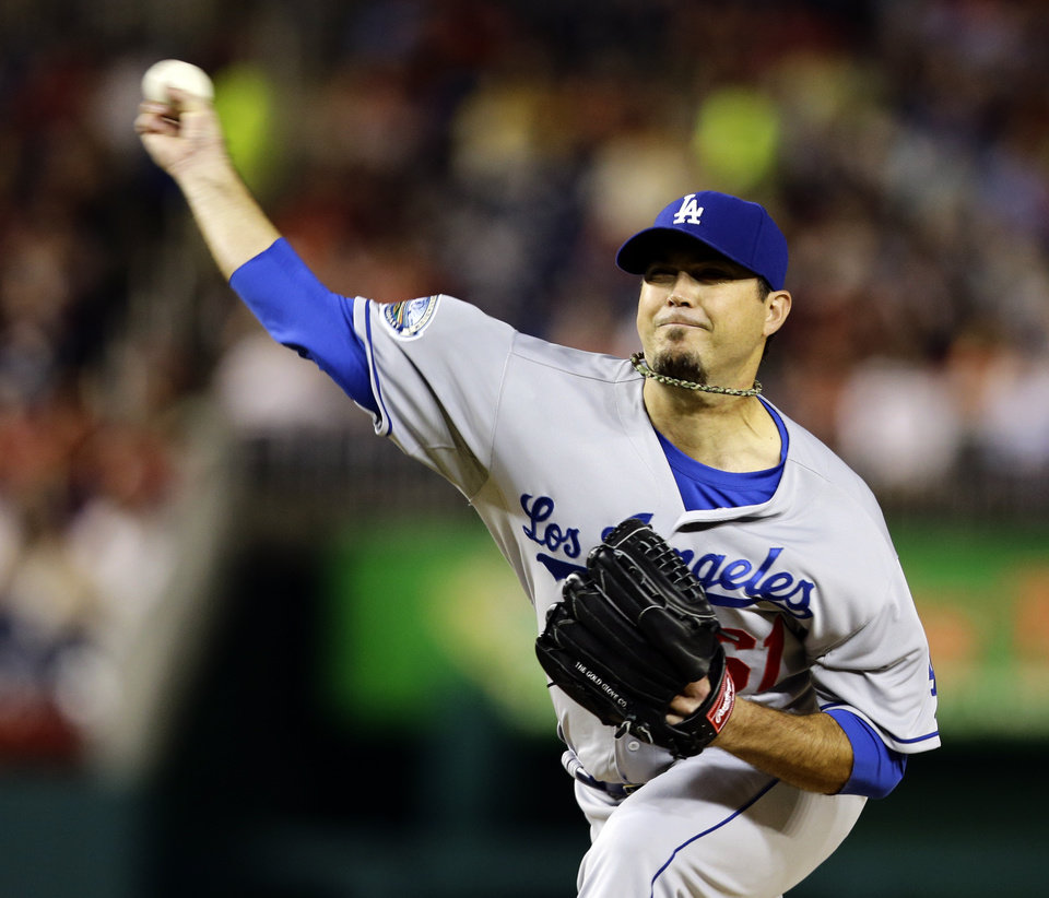 Photo -   Los Angeles Dodgers starting pitcher Josh Beckett throws during the first inning of the second baseball game of a doubleheader against the Washington Nationals, Wednesday, Sept. 19, 2012, in Washington. (AP Photo/Alex Brandon)