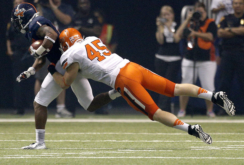 Photo - Oklahoma State's Caleb Lavey (45) brings down UTSA's Kam Jones during the second half of a college football game between the University of Texas at San Antonio Roadrunners (UTSA) and the Oklahoma State University Cowboys (OSU) at the Alamodome in San Antonio, Saturday, Sept. 7, 2013.  Photo by Sarah Phipps, The Oklahoman