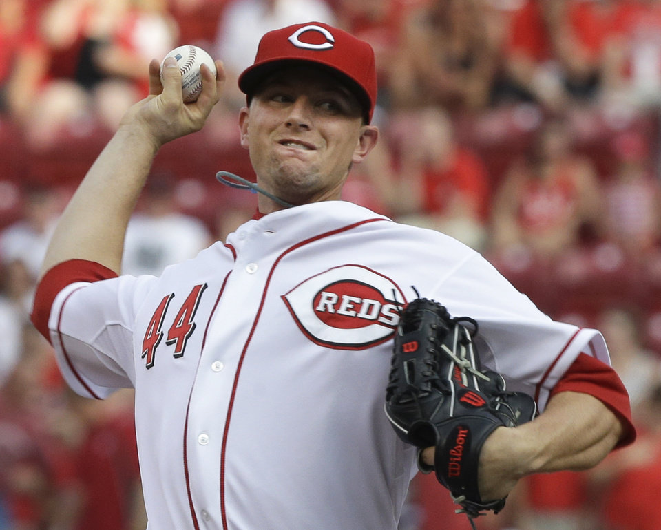 Photo - Cincinnati Reds starting pitcher Mike Leake throws to a Pittsburgh Pirates batter in the first inning of a baseball game, Friday, July 19, 2013, in Cincinnati. (AP Photo/Al Behrman)