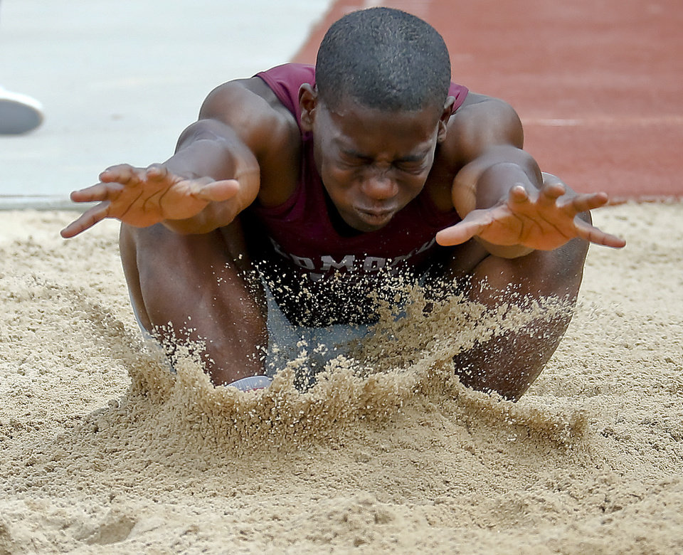Photo - Edmond Memorial's Waylan Anderson competes in the Class 6A boys long during the Class 6A and 5A state championship track meet at Yukon High School on Saturday, May 17, 2014 in Yukon, Okla.   Photo by Chris Landsberger, The Oklahoman