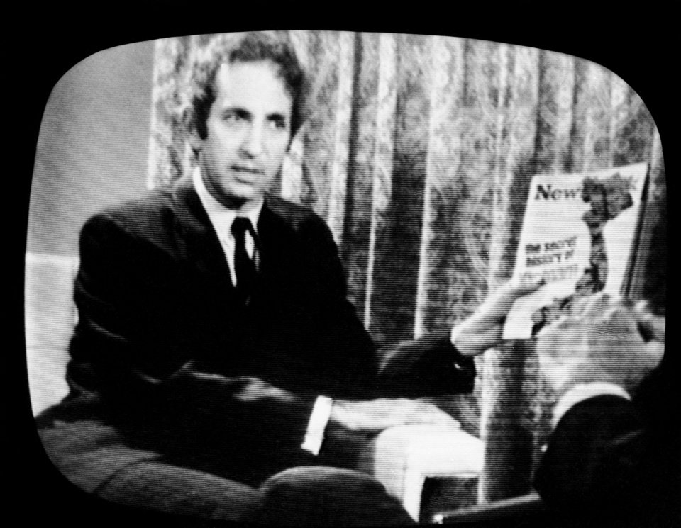 Photo -   FILE - In this June 23, 1971, file photo, Daniel Ellsberg, holds a copy of Newsweek on CBS television program. Newsweek announced Thursday, Oct. 18, 2012 that it will end its print publication after 80 years and shift to an all-digital format in early 2013. Its last U.S. print edition will be its Dec. 31 issue. The paper version of Newsweek is the latest casualty of a changing world where readers get more of their information from websites, tablets and smartphones. It's also an environment in which advertisers are looking for less expensive alternatives online. (AP Photo/CBS, File)