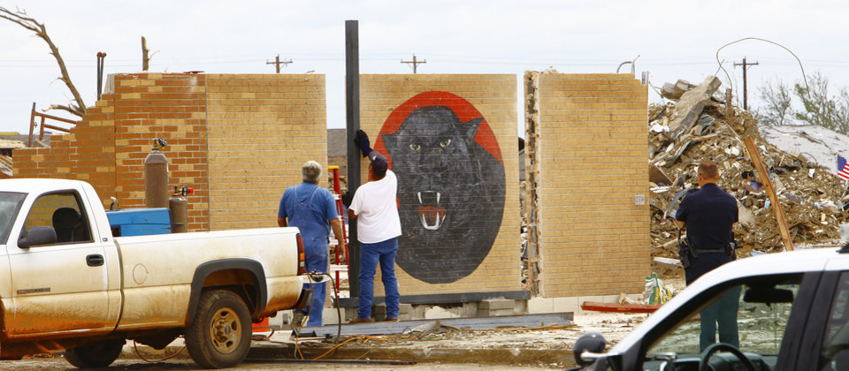 Workers places a frame around the Panther on the wall at Plaza Towers Elementary School in preparation to move it, Thursday, June 6, 2013. Plaza Towers Elementary School demolition after the May 20, 2013 tornado. Photo by David McDaniel, The Oklahoman