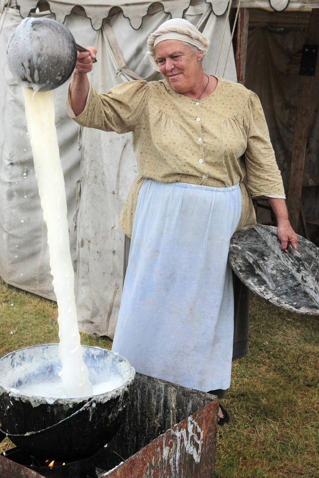 Photo - Deborraha Burnett, from Mountain View, AR, stirs her home made soap at the Scottish Soap Maker display in the Centennial Frontier Experience at the Oklahoma State Fair , Friday, September 13, 2013.  Photo by David McDaniel, The Oklahoman