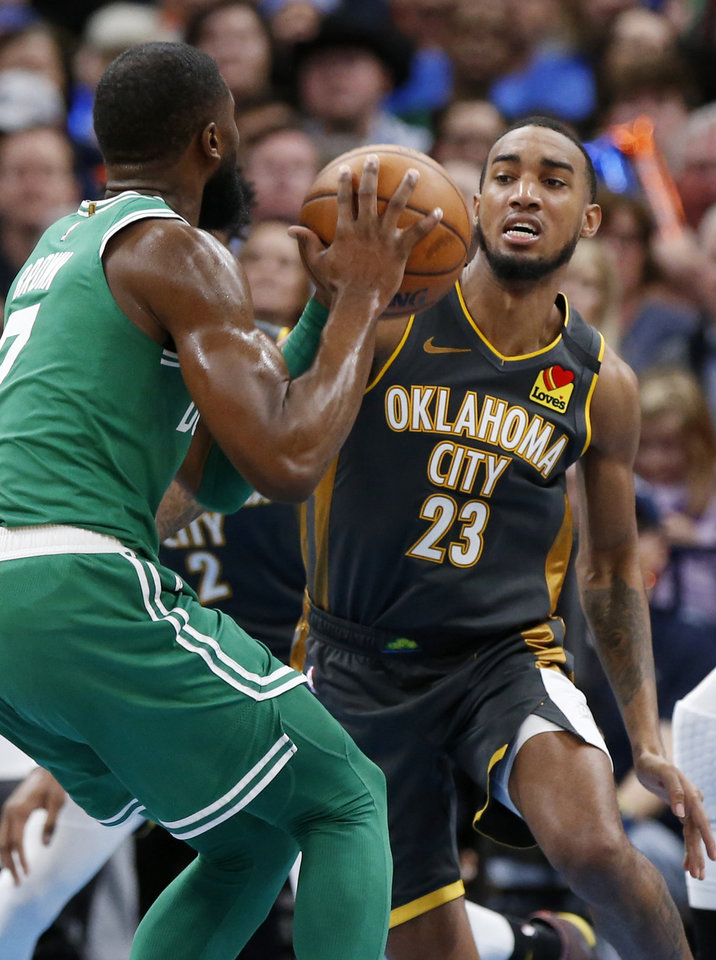 Photo - Oklahoma City's Terrance Ferguson (23) defends Boston's Jaylen Brown (7) in the third quarter during an NBA basketball game between the Oklahoma City Thunder and the Boston Celtics at Chesapeake Energy Arena in Oklahoma City, Sunday, Feb. 9, 2020. Boston won 112-111. [Nate Billings/The Oklahoman]