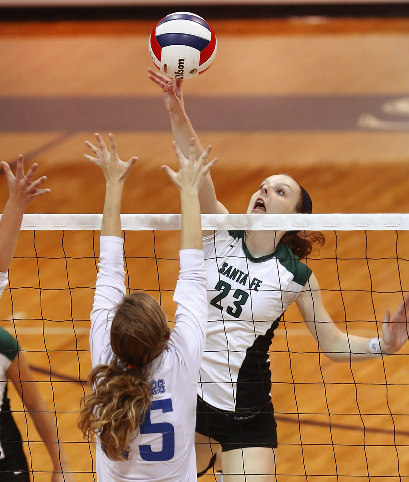Santa Fe\'s Jordan Spence returns a ball on the front line against Stillwater\'s Kaitlyn Cotton in first round action during Stillwater vs. Edmond Santa Fe game in Class 6A volleyball tournament at Shawnee High School on Friday, Oct. 12, 2012. Photo by Jim Beckel, The Oklahoman