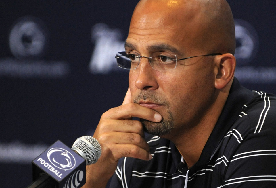 Photo - Penn State NCAA college football head coach James Franklin gestures during a press conference in State College, Pa., Tuesday, Sept. 2, 2014. Penn State is coming off a dramatic win overseas. Now the Nittany Lions hope to keep the hot streak going against Akron. (AP Photo/Centre Daily Times, Nabil K. Mark) MANDATORY CREDIT; MAGS OUT