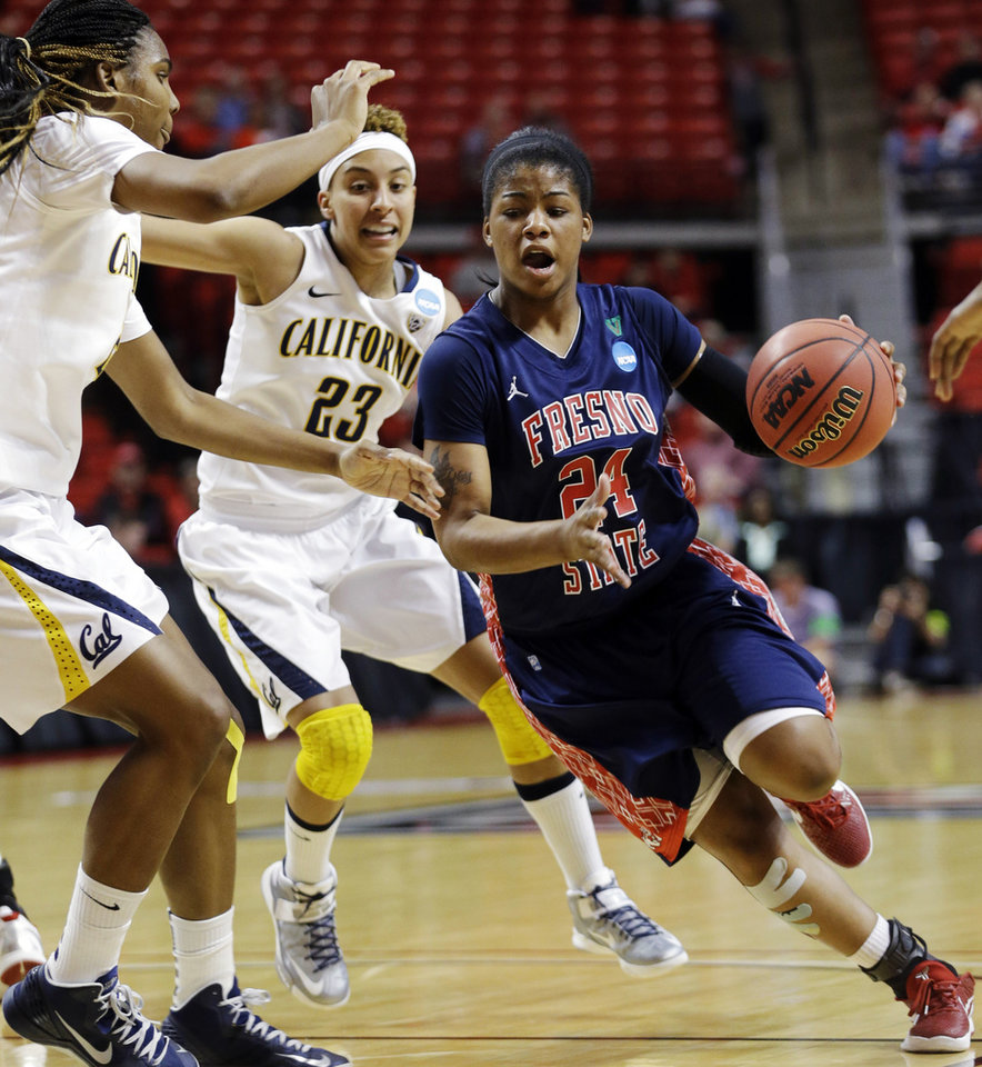 Photo - Fresno State guard Ki-Ki Moore (24) dribbles against California forward Reshanda Gray, left, and guard Layshia Clarendon (23) during the first half of a first-round game in the women's NCAA college basketball tournament in Lubbock, Texas, Saturday, March 23, 2013. (AP Photo/LM Otero)
