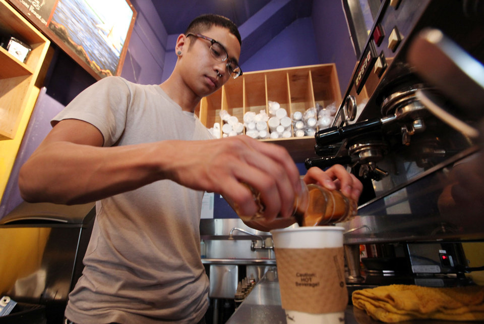 Photo -   In this photo taken Thursday, April 19, 2012, barista Michael Bledsoe prepares a two-shot coffee drink in a coffee shop in Seattle. The college class of 2012 is in for a rude welcome to the world of work. A weak labor market already has left half of young college grads either jobless or underemployed in positions that don't fully use their skills and knowledge. (AP Photo/Elaine Thompson)