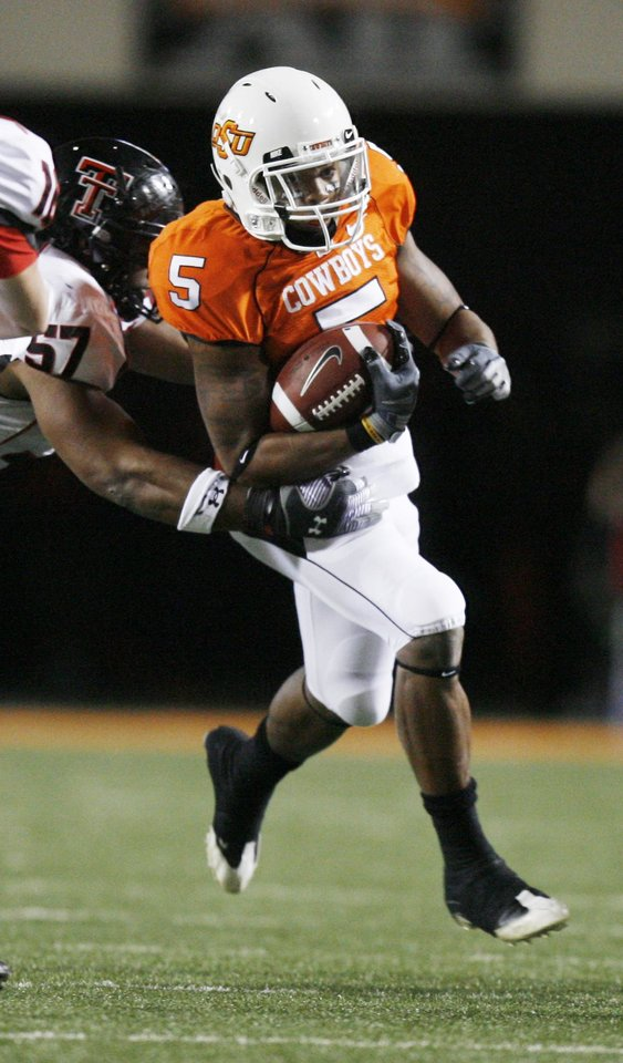 Photo - Cowboy Keith Toston (5) carries the ball during the college football game between Oklahoma State University (OSU) and Texas Tech University at Boone Pickens Stadium in Stillwater, Okla. Saturday, Nov. 14, 2009. Photo by Sarah Phipps, The Oklahoman