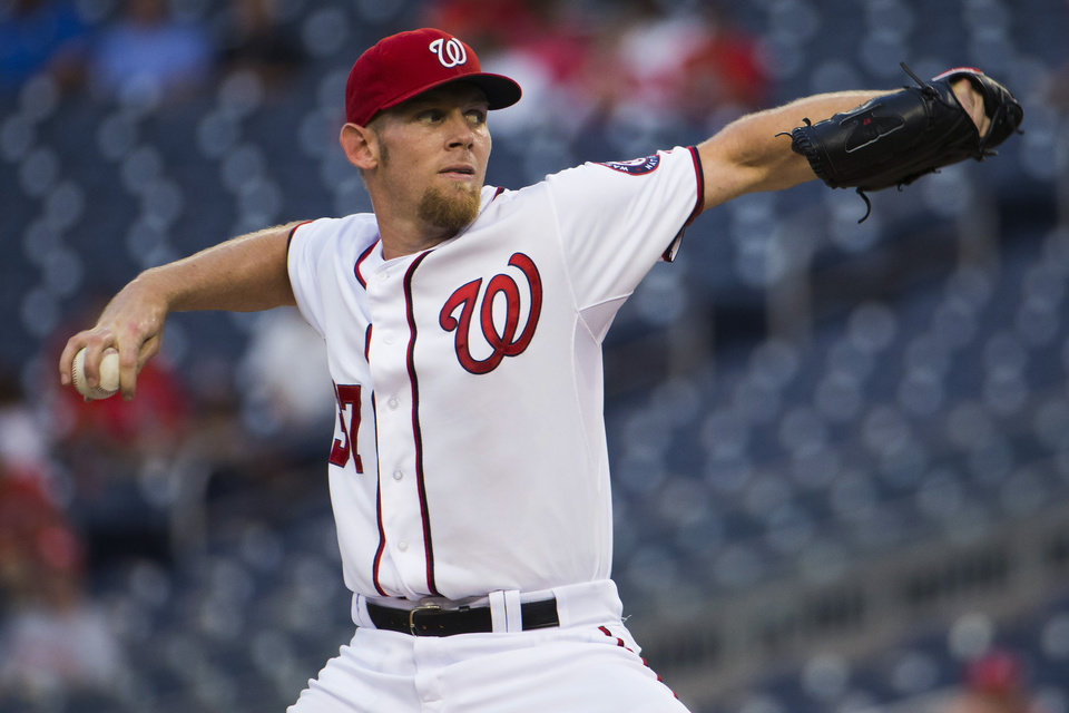 Photo - Washington Nationals starter Stephen Strasburg delivers a pitch during the first inning of a baseball game against the Arizona Diamondbacks on Tuesday, Aug. 19, 2014, in Washington. (AP Photo/Evan Vucci)