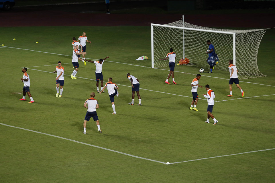 Photo - Netherlands' soccer team train at the Roberto Santos stadium on Friday, July 4, 2014 in Salvador, Brazil. Netherlands play their quarterfinal match of the 2014 World Cup soccer tournament against Costa Rica on July 5 in Salvador.(AP Photo/Wong Maye-E)
