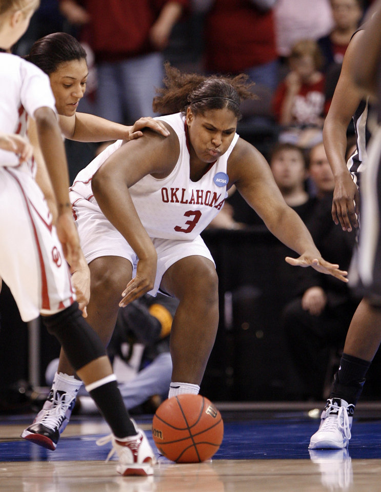 Photo - Courtney Paris tries for a loose ball with Lindsay Wisdom_Hylton on her shoulder in the second half as the University of Oklahoma (OU) plays Purdue in the NCAA women's basketball regional tournament finals at the Ford Center in Oklahoma City, Okla., on Tuesday, March 31, 2009.   Photo by Steve Sisney, The Oklahoman