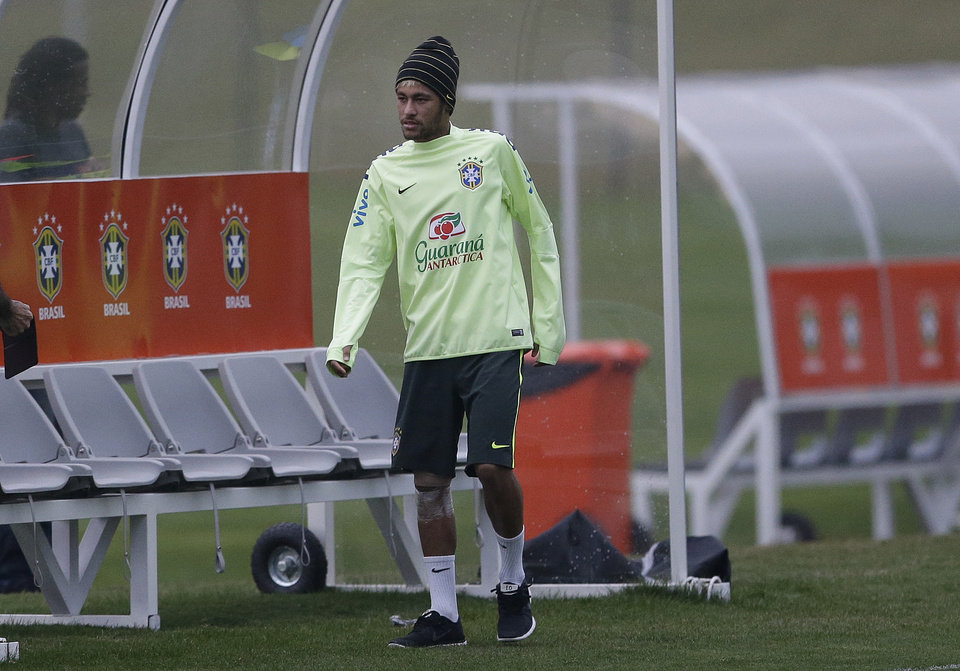 Photo - Brazil's Neymar is seen during a training session at the Granja Comary training center in Teresopolis, Brazil, Tuesday, July 1, 2014. Brazil will face Colombia on July 4 in a quarter-final of the 2014 soccer World Cup. (AP Photo/Andre Penner)