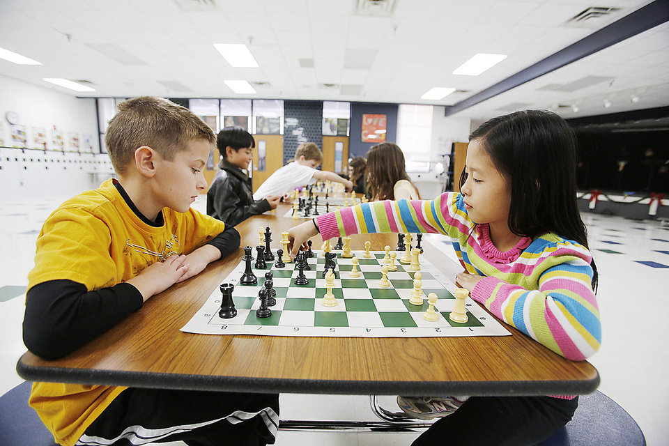 Brandon Townsend, fourth grade, and Jennifer Huang, third grade, play chess during a chess club meeting at Freeman Elementary School in Edmond. Photo By Steve Gooch, The Oklahoman <strong>Steve Gooch - The Oklahoman</strong>