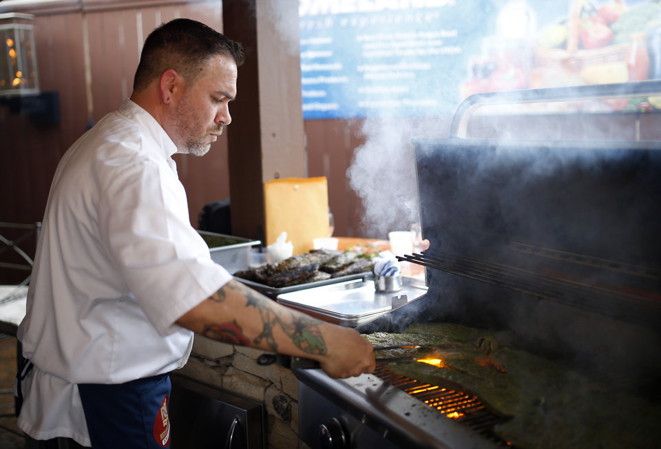 Photo -  Jonas Favela of Boulevard Steakhouse grills during Open Flame. Photo by Sarah Phipps, The Oklahoman   SARAH PHIPPS -  SARAH PHIPPS