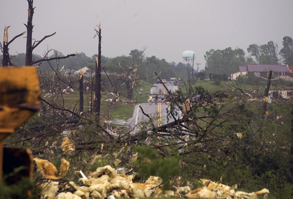 Photo - Trees are sheared off as debris scatters Alabama 13 after a tornado struck Wednesday, April 27, 2011 in Phil Campbell, Ala.  (AP Photo/TimesDaily, Daniel Giles)