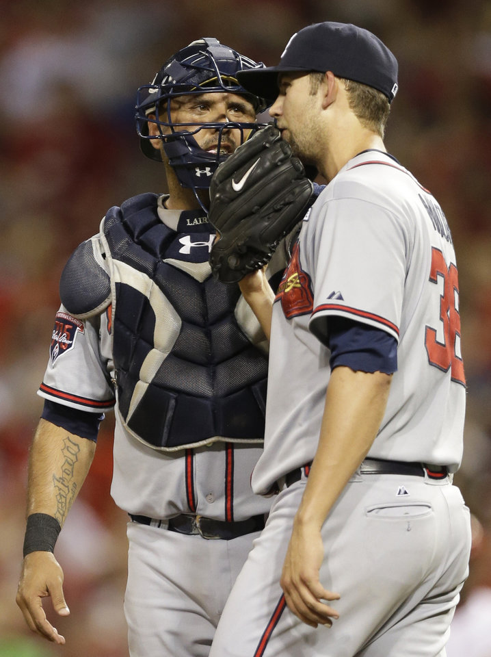 Photo - Atlanta Braves starting pitcher Mike Minor (36) talks with catcher Gerald Laird in the fifth inning of a baseball game against the Cincinnati Reds, Friday, Aug. 22, 2014, in Cincinnati. (AP Photo/Al Behrman)