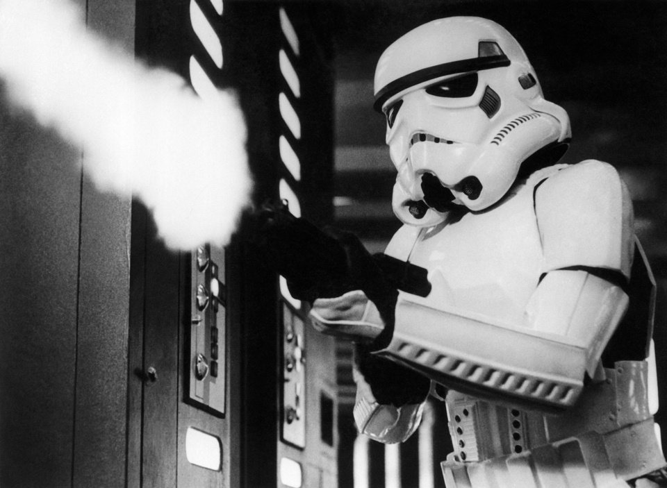 "Photo -  In this image provided by 20th Century-Fox Film Corporation, a scene from ""Star Wars"" movie released by 20th Century-Foxin 1977, where an Imperial stormtrooper, one of the fearsome soldiers of the Galactic Empire, fires at the fleeing Princess Leia. (AP Photo/20th Century-Fox Film Corporation)"