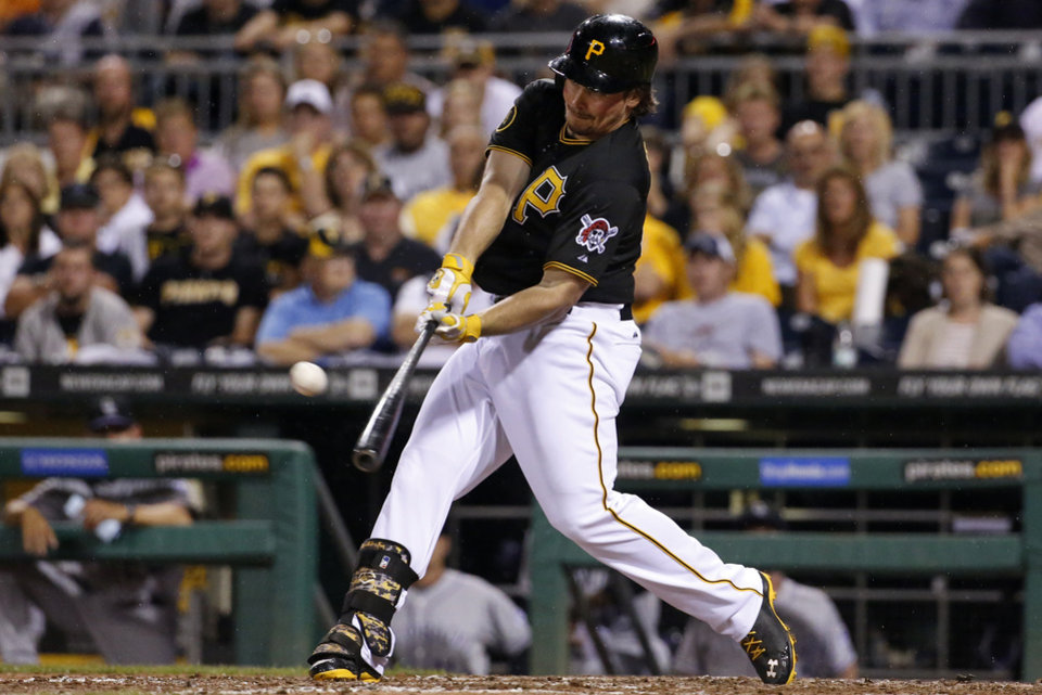 Photo - Pittsburgh Pirates' Travis Snider drives in the go-ahead run with a double off Colorado Rockies relief pitcher Matt Belisle during the eighth inning of a baseball game in Pittsburgh on Friday, July 18, 2014. The Pirates won 4-2. (AP Photo/Gene J. Puskar)