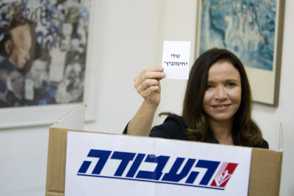 Photo - FILE - In this Monday, Sept. 12, 2011 file photo, Israel's Labor party candidate and former journalist Shelly Yachimovich holds a ballot with her name before casting her vote in Tel Aviv, Israel. Israel's Labor Party will be fielding a large number of former journalists in the country's upcoming parliamentary elections. Six former journalists, including party chairwoman Shelly Yachimovich, figure among the top 25 labor candidates who will be running in the Jan. 22 parliamentary race. The party held its primary on Thursday and released the list of candidates on Friday. (AP Photo/Ariel Schalit, File)