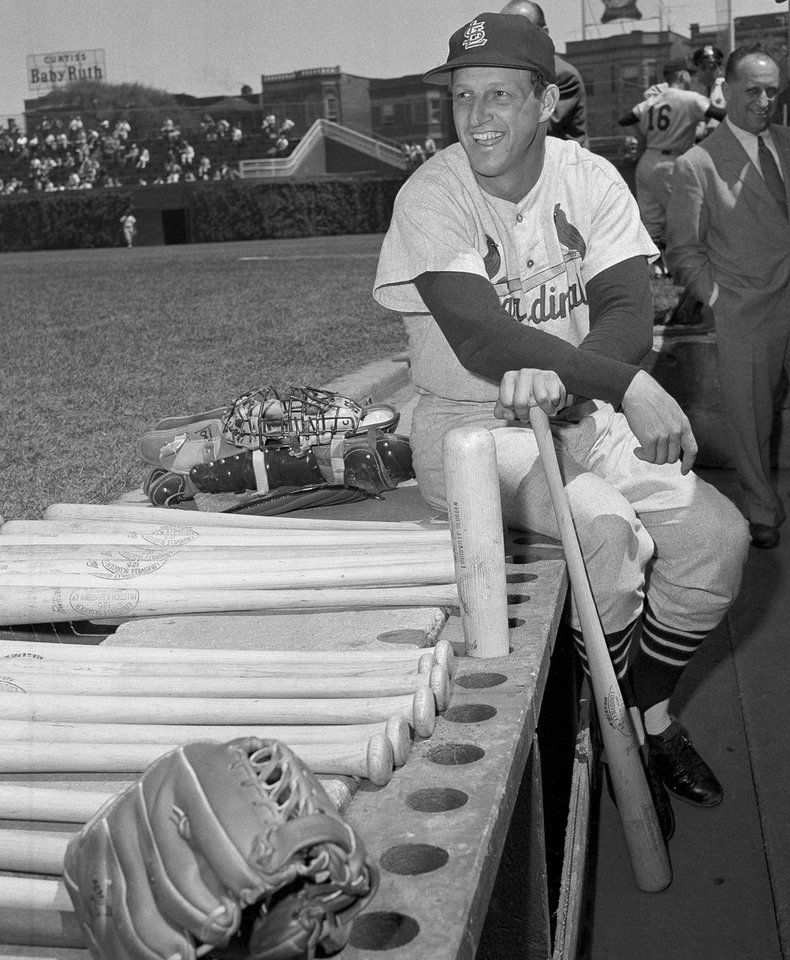 FILE - In this May 13, 1958 file photo, Stan Musial, St. Louis Cardinal all-time great baseball player, poses in dugout prior a baseball game against the Chicago Cubs in Chicago. Musial made his 3,000th career hit in the game. Musial, one of baseball's greatest hitters and a Hall of Famer with the Cardinals for more than two decades, died Saturday, Jan. 19, 2013, the team announced. He was 92. (AP Photo/File)