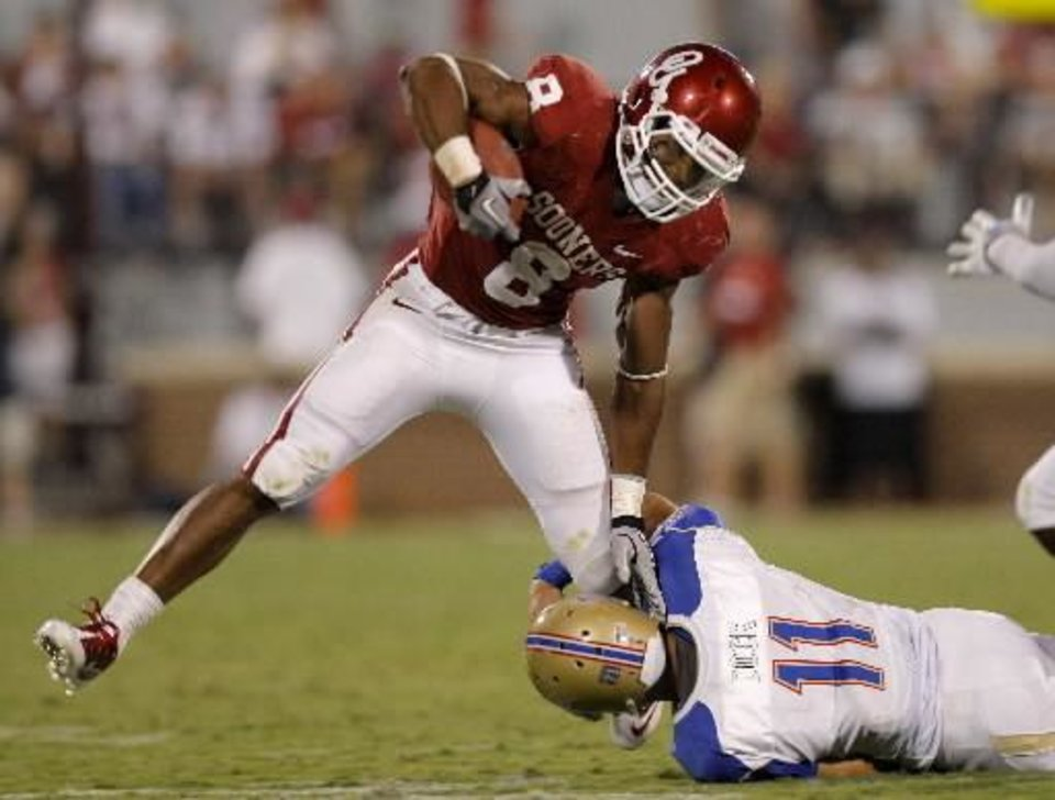 Photo - Oklahoma's Dominique Whaley (8) gets past Tulsa's Alan Dock (11) on his way to a touchdown in the third quarter of the college football game between the University of Oklahoma Sooners ( OU) and the Tulsa University Hurricanes (TU) at the Gaylord Family-Memorial Stadium on Saturday, Sept. 3, 2011, in Norman, Okla. Oklahoma won 47-14. Photo by Bryan Terry, The Oklahoman ORG XMIT: KOD