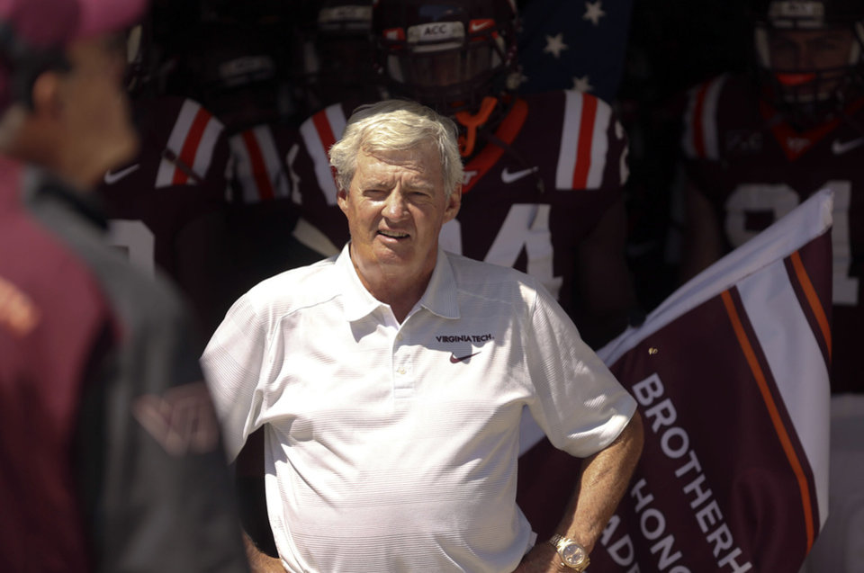 Photo - In this photo taken Sept. 7, 2013, Virginia Tech head foach Frank Beamer and his team prior to taking the field for an NCAA college football game against Western Carolina in Blacksburg Va. (AP Photo/The Roanoke Times, Matt Gentry) LOCAL TV OUT; SALEM TIMES REGISTER OUT; FINCASTLE HERALD OUT;  CHRISTIANBURG NEWS MESSENGER OUT; RADFORD NEWS JOURNAL OUT; ROANOKE STAR SENTINEL OUT MBI