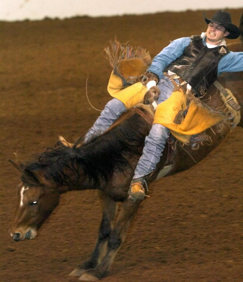Guthrie, Friday, November 14, 2003.  Jet McCoy of Weatherford rides Brown Sugar during the Bareback competition at the Dodge Prairie Circuit Rodeo at the Lazy E.  Staff photo by Bryan Terry