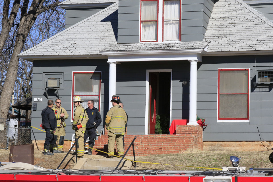 Photo -  A woman's body was found after a fire at this duplex in the 1800 block of NW 9. [Photo by Paul Hellstern, The Oklahoman]