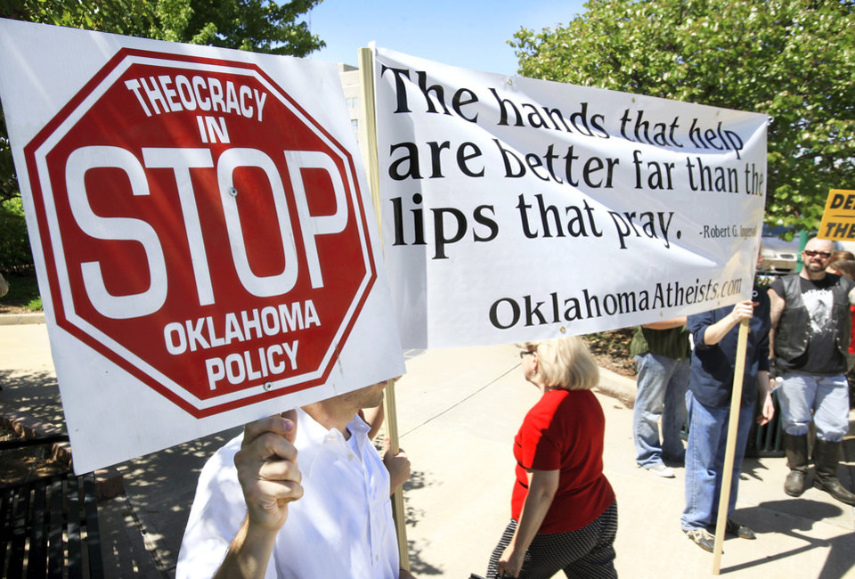 Photo - A small group of people representing Oklahoma Atheists stood across the street from the National Day of Prayer service Thursday at the state Capitol.  Photo by Jim Beckel, The Oklahoman