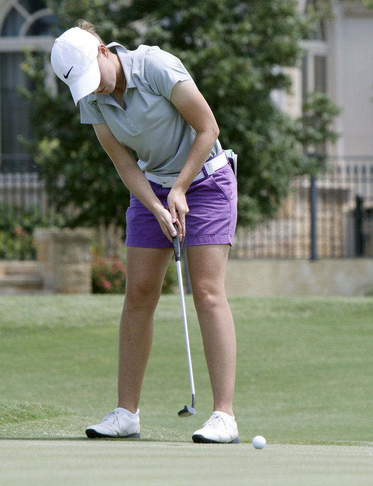 Photo - Lucy Nunn putts during the match play semifinals of the WSGA championship at Gaillardia Country Club in Oklahoma City, OK, Thursday, June 5, 2014,  Photo by Paul Hellstern, The Oklahoman