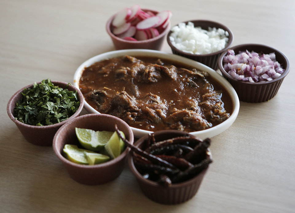 Birria with condriments from  Birrieria Diaz in Bethany, <strong>Garett Fisbeck - Garett Fisbeck</strong>