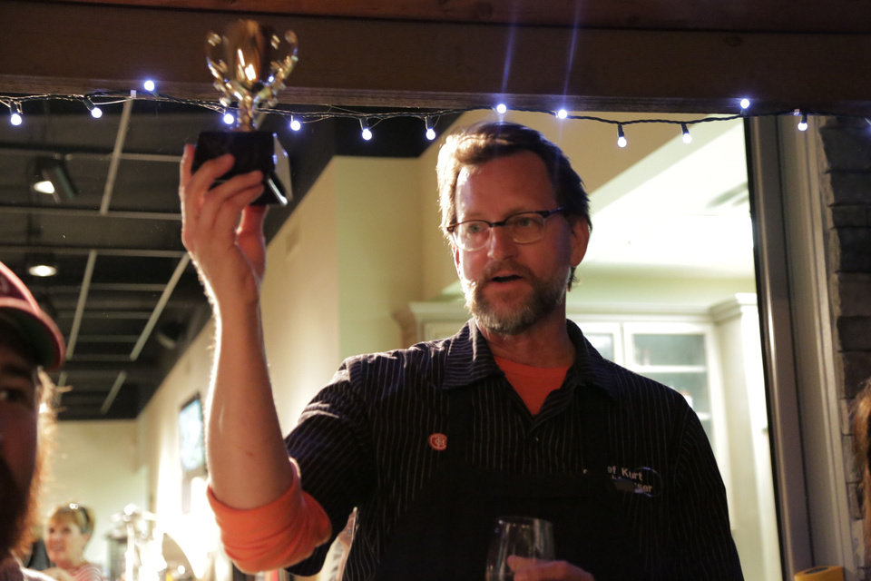 Chef Kurt Fleischfresser holds his team's tailgating trophy. PHOTO BY KYLE ROBERTS, THE OKLAHOMAN <strong></strong>