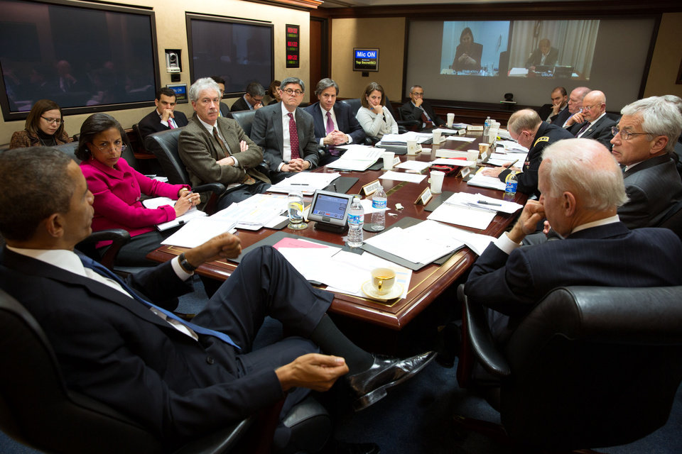 Photo - In this image released by the White House, President Barack Obama, left, convenes a National Security Council meeting in the Situation Room of the White House to discuss matters in Ukraine, on Monday, March 3, 2014, in Washington. At right is Vice President Joe Biden. (AP Photo/The White House, Pete Souza)