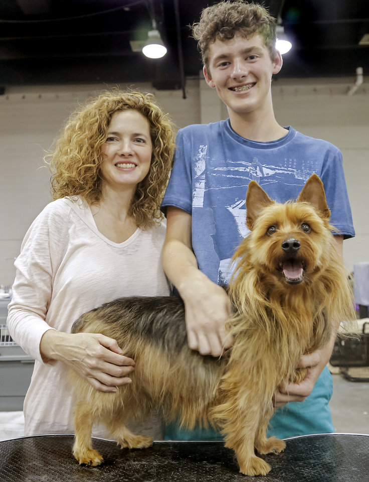 Photo -  Bonni Wilson and her son, Kade, of Moore, pose for a photo with their Australian terrier, Cody, while attending the OKC Summer Classic Dog Shows. Photo by Chris Landsberger, The Oklahoman   CHRIS LANDSBERGER -